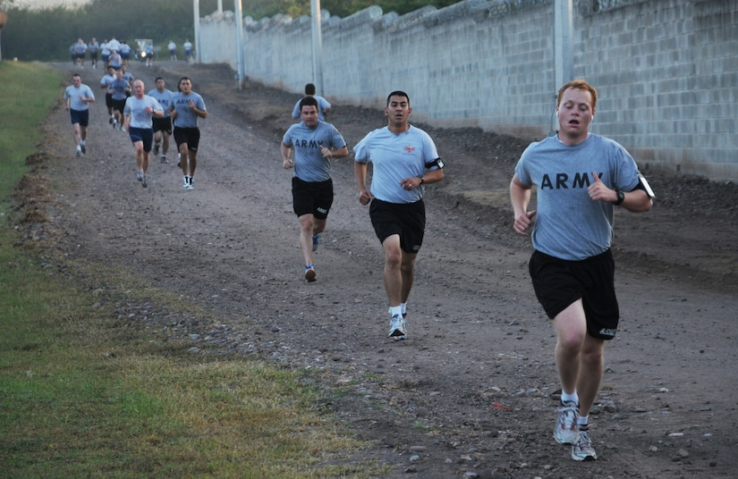 SOTO CANO AIR BASE, Honduras --  Coming back downhill, Team Bravo members make the return trip along the Turkey Trot route here Nov. 22. The run was sponsored by the base Morale, Welfare and Recreation office. (U.S. Air Force photo/Tech. Sgt. Benjamin Rojek)