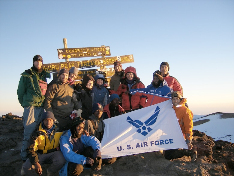Capt. Graydon Muller (far left, standing), and Capt. Rob Marshall (far right, kneeling) pose at the summit of Mt. Kilimanjaro, the highest peak in Africa, as part of the U.S. Air Force Seven Summits Challenge in July 2006. The U.S. Air Force Seven Summits Challenge is an endeavor for Air Force members to carry the Air Force flag to the highest point on each continent and to be the first U.S. military group to conquer all seven peaks. Captains Muller and Marshall will depart Nov. 24, 2010 to attempt the group?s fifth summit, Vinson Massif in Antarctica. Captain Muller is a member of the 6th Special Operations Squadron. Captain Marshall is a member of the 8th Special Operations Squadron. (U.S. Air Force photo)