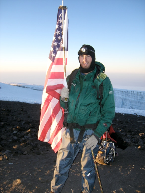 Capt. Graydon Muller poses at the summit of Mt. Kilimanjaro, the highest peak in Africa, as part of the U.S. Air Force Seven Summits Challenge in July 2006. The U.S. Air Force Seven Summits Challenge is an endeavor for Air Force members to carry the Air Force flag to the highest point on each continent and to be the first U.S. military group to conquer all seven peaks. Captain Muller and Capt. Rob Marshall will depart Nov. 24, 2010 to attempt the group's fifth summit, Vinson Massif in Antarctica. Captain Muller is a member of the 6th Special Operations Squadron at Hurlburt Field, Fla. Captain Marshall is a member of the 8th SOS. (Courtesy photo)