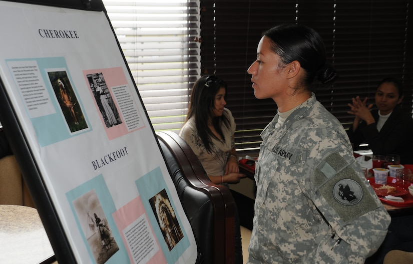 SOTO CANO AIR BASE, Honduras --  Staff Sgt. Raquel Martinez, of the Army Forces here, reads a brief history of the Cherokee tribe during the Native America Heritage Luncheon at the dining facility here Nov. 17. The heritage celebration month, which has taken place every November since 1994, can be traced back to the early 20th century. At that time, Native Americans first began an effort to gain a day of recognition for the significant contributions the first Americans made to the establishment and growth of the U.S. (U.S. Air Force photo/Tech. Sgt. Benjamin Rojek)