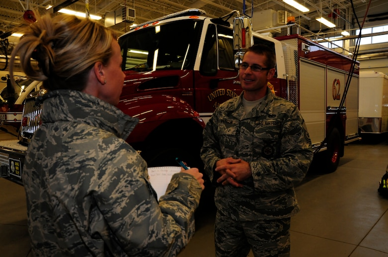 "2nd Lt. Jodi Kiminski interviews Master Sgt. Mark Watczak, Assistant Fire Chief of the 148 Fighter Wing on Nov. 20, 2010. Watczak, a 20 year veteran of the 148th FW, was recently recognized as Military Fire Fighter of the Year and presented with ""The Chief Albert Fitzpatrick Award."" (U.S. Air Force photo by Senior Airman Sarah C. Hayes)"