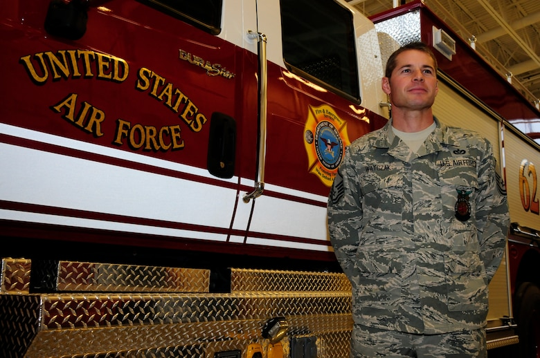 "Master Sgt. Mark Watczak, Assistant Fire Chief of the 148th Fighter Wing, Duluth, Minn., stands in front of a medium rescue truck while being interviewed on Nov. 20, 2010. Watczak, a 20 year veteran of the 148th FW, was recently recognized as Military Fire Fighter of the Year and presented with ""The Chief Albert Fitzpatrick Award."" (U.S. Air Force photo by Senior Airman Sarah C. Hayes)"