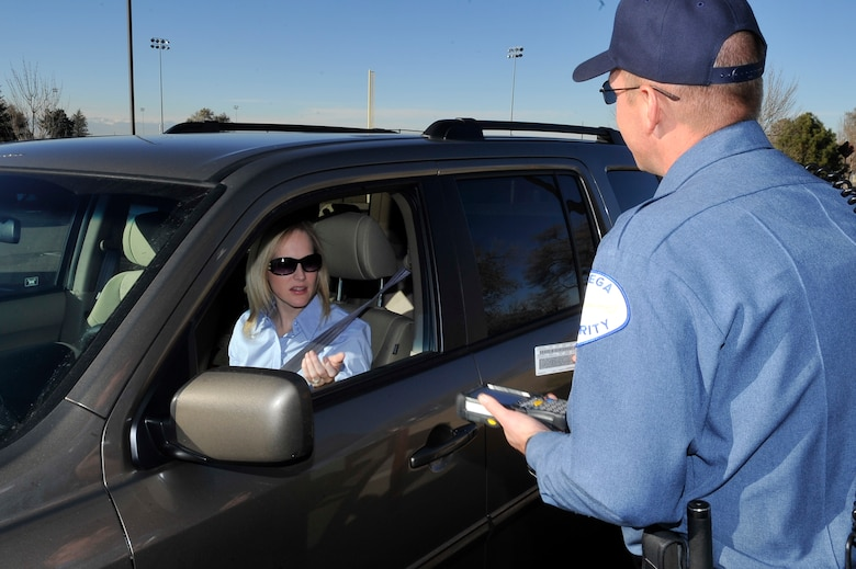 Officer Casey Lemieux, Chenega Security scans a Common Access Card with the new DBIDS system implemented at Buckley Air Force Base Nov 23, 2010. Buckley Identification Cards will be a one for one swap for the DBIDS card(U.S. Air Force photo by Airman 1st Class Paul Labbe.)