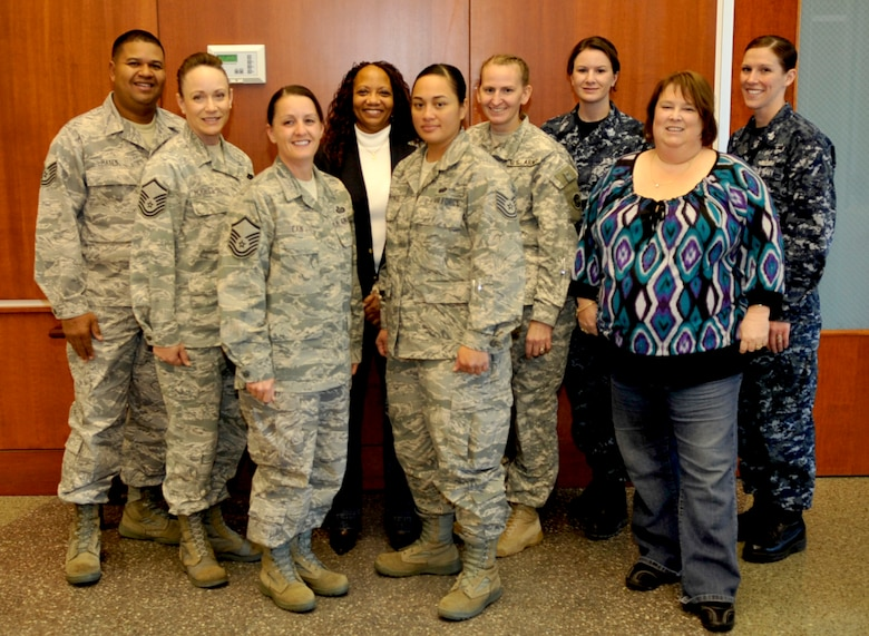 Buckley Victim Advocates Tech. Sgt. John Hayes, Master Sgt. Lisamichelle Hughes-Belt, Master Sgt. Karen Cain, Ms Peggy Moore-McCoy,TSgt Annie Fernandez, Maj. Alisa Englert, Petty Officer 1st Class Amanda McNeely, Ms. Tammy Jordan, Petty Officer 1st Class Erika Burrell pose for a photo on Nov 5, 2010. (Air Force Photo by Airman First Class Paul Labbe.)