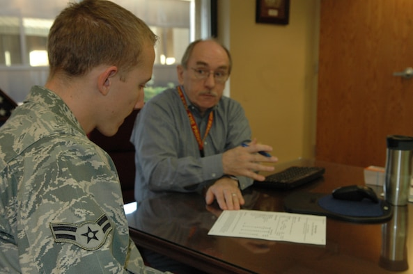 J.D. Coy, an education counselor with the 72nd Force Support Squadron Education Services Office, goes over a Community College of the Air Force education plan with Airman 1st Class Waylon Branscom, 72nd Medical Group. Airman Branscom wants to become a teacher when he is finished with his military career. The 72nd Medical Group set up a site visit for Mr. Coy to provide education counseling to Airmen without them having to leave the clinic. (Air Force photo by Micah Garbarino)