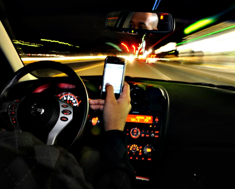 For every six seconds of driving time, a driver text messaging will spend nearly five of those seconds with their eyes off the road. Neither talking nor texting while driving on a military installation is allowed. (U.S. Air Force photo/Staff Sgt. Andrea Thacker)(RELEASED)