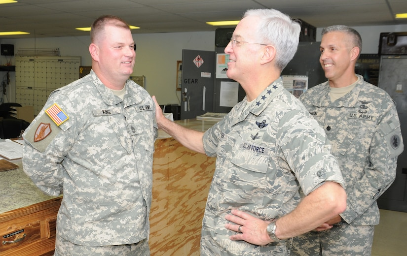 SOTO CANO AIR BASE, Honduras --  Gen. Douglas Fraser, center, the commander of U.S. Southern Command, chats with Sgt. 1st Class Alan King, left, of the 1-228th Aviation Regiment, as Lt. Col. James Kanicki, the 1-228th commander, looks on. General Fraser visited with Team Bravo members to thank them for their service. (U.S. Air Force photo/Tech. Sgt. Benjamin Rojek)