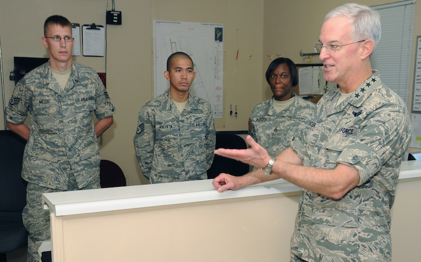 SOTO CANO AIR BASE, Honduras --  Gen. Douglas Fraser, right, the commander of the U.S. Southern Command, chats with members of the Medical Element here Nov. 25. Stopping by different offices on base, General Fraser took time on Thanksgiving to show his appreciation for what Team Bravo is doing in Central America. (U.S. Air Force photo/Tech. Sgt. Benjamin Rojek)