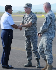 SOTO CANO AIR BASE, Honduras --  Col. Wilfredo Reyes, the director of the Honduran Military Academy here, greets Gen. Douglas Fraser, the commander of the U.S. Southern Command, on the flightline here Nov. 25. General Fraser visited different units here to personally thank Team Bravo members for their service. (U.S. Air Force photo/Tech. Sgt. Benjamin Rojek)