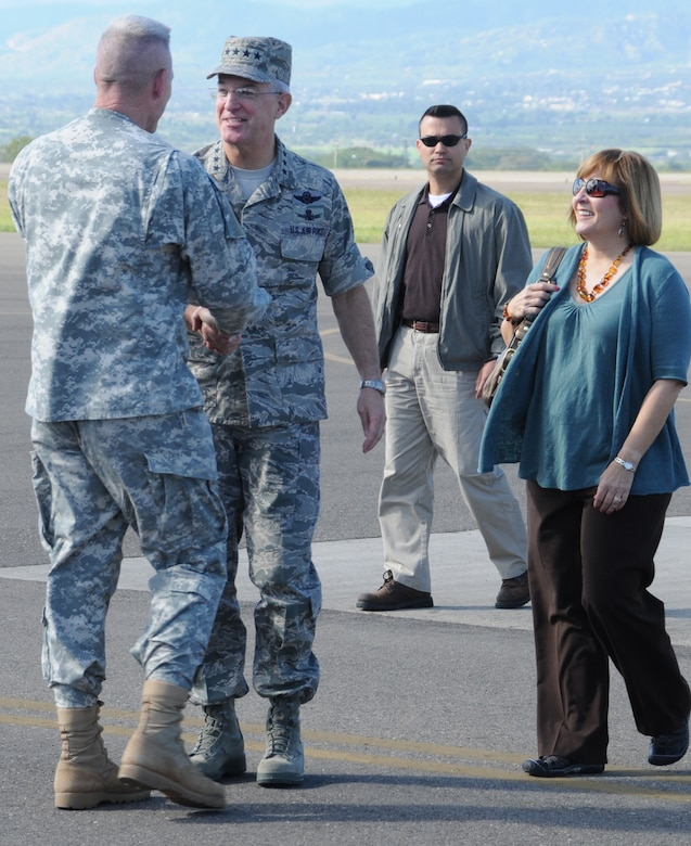 SOTO CANO AIR BASE, Honduras --  Col. Gregory Reilly, left, the Joint Task Force-Bravo commander, greets Gen. Douglas Fraser, the commander of the U.S. Southern Command, and his wife Rena on the flightline here Nov. 25. General Fraser visited Soto Cano to visit with and thank Team Bravo members for their service. (U.S. Air Force photo/Tech. Sgt. Benjamin Rojek)