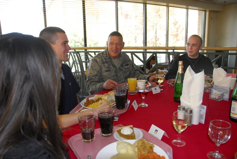 Gen. Gary North, Pacific Air Forces commander, shares a Thanksgiving meal Nov. 25 with Airmen at the Gingko Tree dining facility, Osan Air Base, Republic of Korea. (U.S. Air Force photo/Staff Sgt. Eunique Stevens)