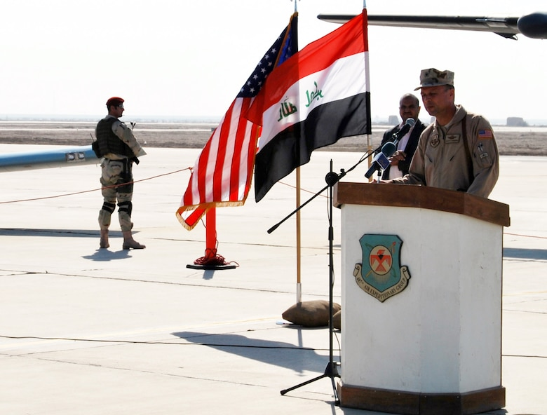 Brig. Gen. Scott Hanson, Commander of the 321st Air Expeditionary Wing and Director of Iraqi Training and Advisory Mission –  Air Force addresses audience members gatherd at Ali Air Base, Iraq, during a ceremony celebrating the arrival of the Iraqi Air Force's Squadron 70 and the grand opening of their new dining facility.  Squadron 70 moved to Ali Base Oct. 17 from Basra. Since the move, Squadron 70 has provided surveillance and reconnaissance support of the Hajj, provided ISR support for Iraqi Security Forces and secured Iraqi's vital infrastructure and borders.(U.S. Air Force photo by Staff Sgt. Eric Donner)