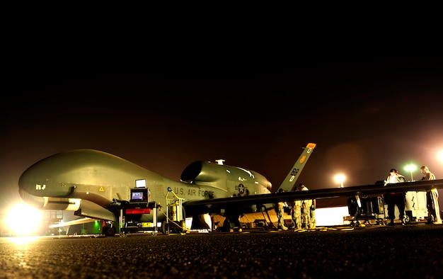 An RQ-4 Global Hawk gets prepared for a mission while deployed Nov. 23, 2010, at an air base in Southwest Asia. The RQ-4 and the Airmen are assigned to the 380th Expeditionary Operations Group. (U.S. Air Force photo/Staff Sgt. Andy M. Kin)