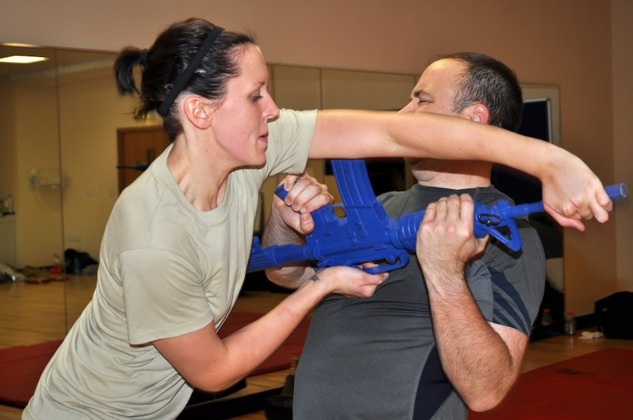RAF MILDENHALL, England -- Senior Airman Shealyn Storm, 352nd Special Operations Support Squadron, disarms Capt. Daniel Dittrich, 352nd Special Operations Maintenance Squadron, using a long-gun takeaway technique she learned during a Krav Maga class Oct. 26, 2010. The class, once only offered to the members of the 352nd SOSS, is now open to all members of the 352nd Special Operations Group. It is taught by trained instructors assigned to the 352nd SOG's security forces flight. (U.S. Air Force photo/Tech. Sgt. Marelise Wood)