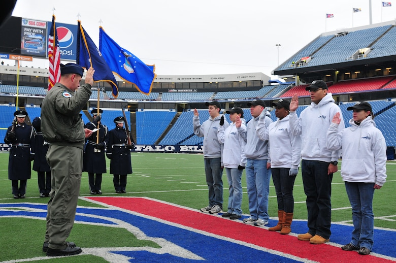 During a Buffalo Bills pregame ceremony held Sunday morning, six of the newest members of the New York Air National Guard's 107th Airlift Wing took the Oath of Enlistment. The ceremony was played during halftime on the Jumbotron for the fans to see.  Lt. Col. James Hoch swears in from left to right Airmen 1st class Daniel Tremblett, Cara Sturdivant, Keith McArthur, Christina Swanson, Joshua Velez and Joanna Vail. (U.S. Air Force photo/Tech. Sgt. Justin Huett)