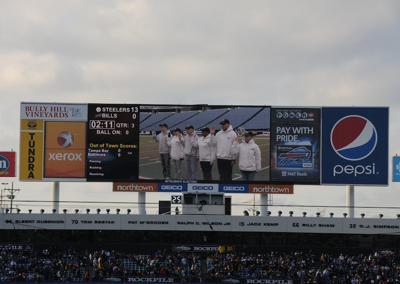 During a Buffalo Bills pregame ceremony held Sunday morning, six of the newest members of the New York Air National Guard's 107th Airlift Wing took the Oath of Enlistment. The ceremony was played during halftime on the Jumbotron for the fans to see.  Lt. Col. James Hoch swears in from left to right Airmen 1st class Daniel Tremblett, Cara Sturdivant, Keith McArthur, Christina Swanson, Joshua Velez and Joanna Vail.  (U.S. Air Force photo/Staff Sgt. Peter Dean)