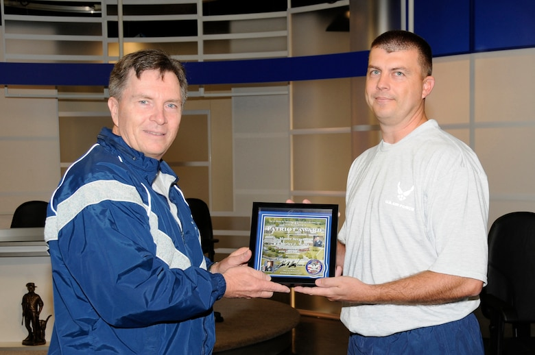 McGHEE TYSON AIR NATIONAL GUARD BASE, Tenn. - Col. Richard B. Howard, left, commander of The I.G. Brown Air National Guard Training and Education Center here, presents his Patriot Award to Master Sgt. Jason Wolfe, right, NCOIC of infrastructure management for the communications focal point section, for recognition of his contributions to the center, Nov. 24, 2010. The Patriot Award is Howard's personal award to show appreciation for those he feels have gone above and beyond in their service. (U.S. Air Force photo by Master Sgt. Kurt Skoglund/Released)