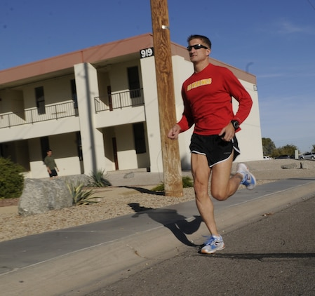 Gunnery Sgt. Scott Hubbard, 35, criminal investigation division chief investigator, runs on the Marine Corps Air Station in Yuma, Ariz., Nov. 30, 2010. Hubbard is in the top 1 percent of marathon runners in the world, breaking the three-hour-finish mark in the Marine Corps Marathon.