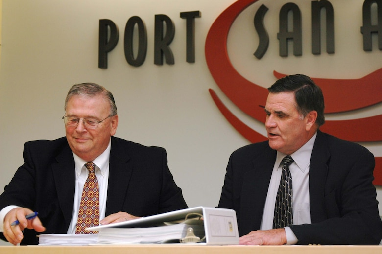 Mr. Bob Moore, AFRPA Director, and Mr. Bruce Miller, President and CEO of Port San Antonio, sign the deed to transfer the remaining 389 acres of the former Kelly Air Force Base to the Port of San Antonio.