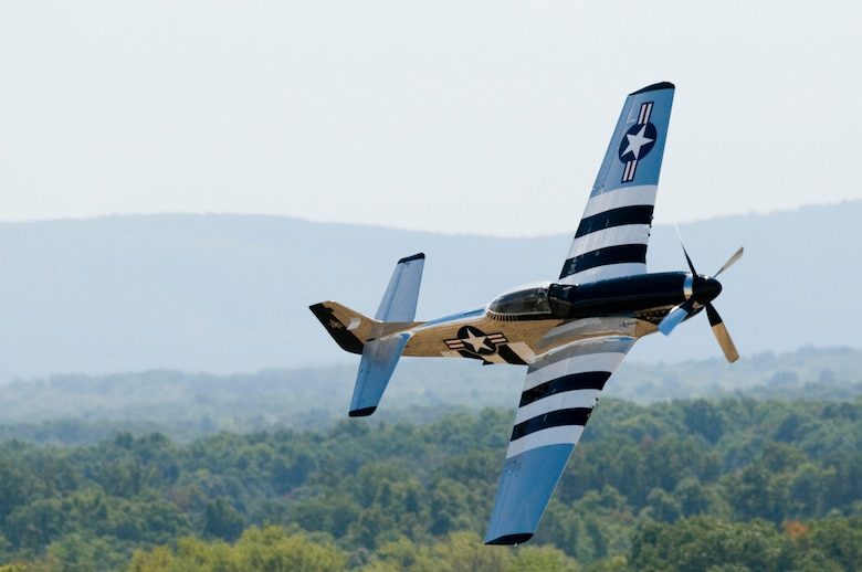 A P-51 Mustang named Quicksilver, piloted by Scott Yoak of Lewisburg, WV performs during the Thunder Over the Blue Ridge Open House and Air Show. The 167th Airlift Wing, West Virginia Air National Guard unit in Martinsburg, WV held an open house in conjuction with the Thunder Over the Blue Ridge Air Show on September 4 and 5, 2010. The U.S. Air Force Thunderbirds and the U.S. Army Golden Knights headlined the show. (U.S. Air Force photo by MSgt Sean Brennan)