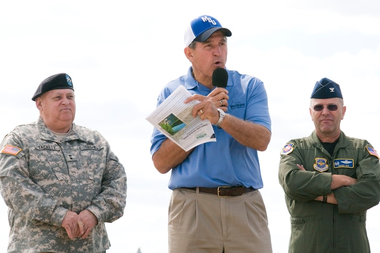 West Virginia Adjutant General, Major General Alan Tackett and 167th Airlift Wing commander, Colonel Roger Nye stand behind West Virginia Governor, Joe Manchin III, as he speaks during the opening ceremonies of the Thunder Over the Blue Ridge Open House and Air Show. The 167th Airlift Wing, West Virginia Air National Guard unit in Martinsburg, WV held an open house in conjuction with the Thunder Over the Blue Ridge Air Show on September 4 and 5, 2010. The U.S. Air Force Thunderbirds and the U.S. Army Golden Knights headlined the show. (U.S. Air Force photo by MSgt Emily Beightol-Deyerle)