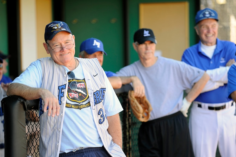 Bruce Huneke watches an Air Force baseball reunion game Sept. 24, 2010, along with Allan Macartor and Jim Steed. Huneke is a 1965 Academy graduate and Vietnam veteran; Macartor and Steed are both 1964 graduates. (U.S. Air Force photo/Mike Kaplan)