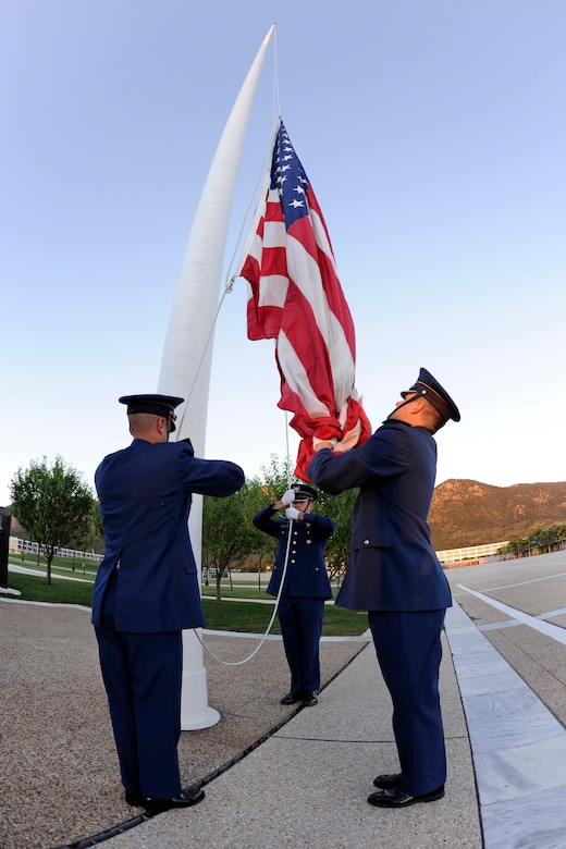 A cadet honor guard prepares to raise an American flag at the Air Force Academy during a reveille ceremony in memory of Cadet 1st Class Marc Henning Sept. 28, 2010. The Academy and Cadet Henning's family held a memorial service at the Cadet Chapel the same day. (U.S. Air Force photo/Mike Kaplan)