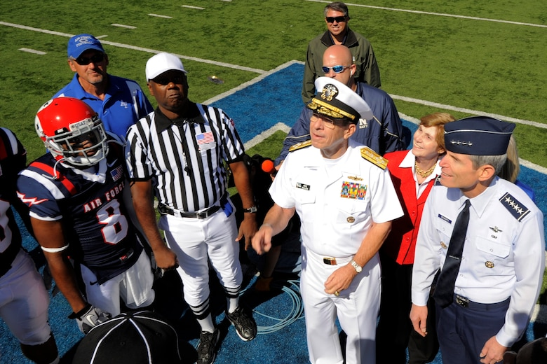 Chairman of the Joint Chiefs of Staff Adm. Mike Mullen and Air Force Chief of Staff Gen. Norton Schwartz participate in the coin toss prior to the start of the Air Force vs. Navy game at the U.S. Air Force Academy's Falcon Stadium in Colorado Springs, Colo., Oct. 2, 2010.  Air Force defeated Navy 14-6.  This was the Falcons' first victory over Navy since 2002. (U.S. Air Force photo/Mike Kaplan)