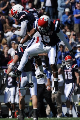 Defensive backs Jon Davis and Reggie Rembert celebrate as Air Force defeated Navy 14-6 at the U.S. Air Force Academy's Falcon Stadium in Colorado Springs, Colo., Oct. 2, 2010.  This was the Falcons' first victory over Navy since 2002.  (U.S. Air Force photo/Johnny Wilson)