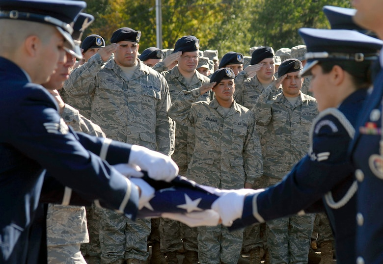 Members of the 103rd Base Honor Guard, Connecticut Air National Guard, finish folding the American Flag  during a Sept. 11, 2010 flag-folding ceremony held at Bradley Air Park, Bradley Air National Guard Base, East Granby, Conn. (U.S. Air Force photo by Tech. Sgt. Joshua Mead)
