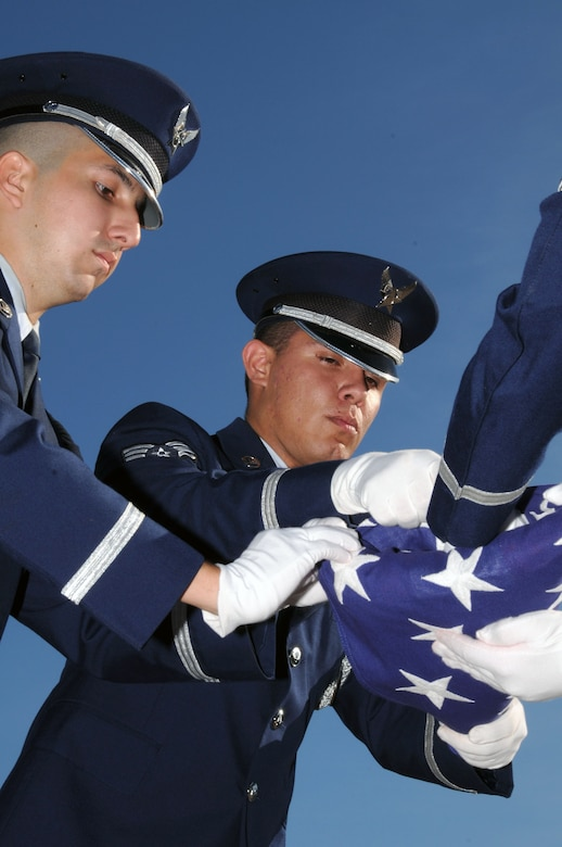 Members of the 103rd Base Honor Guard, 103rd Airlift Wing, finish folding the American Flag during a Sept. 11, 2010 flag-folding ceremony at the Bradley Air Park, Bradley Air National Guard Base, East Granby, Conn. (U.S. Air Force photo by Tech. Sgt. Theodore Andrews)