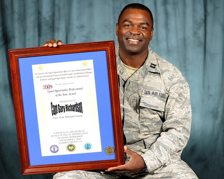 """174th Fighter Wing Social Actions Officer, Captain Gary Richardson of the 174th Fighter Wing, Syracuse NY shows off the """"Equal Opportunity Professional of the Year Award"""" he received at the September 2nd 2010 Annual National Guard EO conference held in Garden Grove, CA. (Us Air Force Photo by: Staff Sgt. James N. Faso II/Released)"""