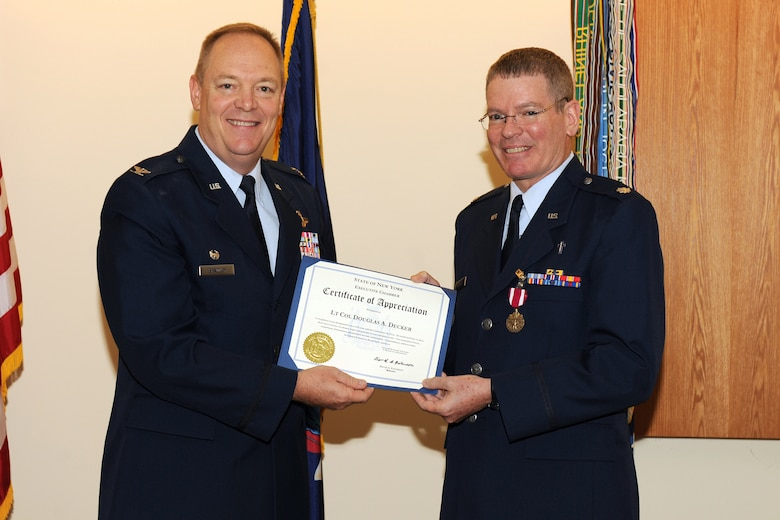 Col. Kevin W. Bradley, Commander of the 174th Fighter Wing, Syracuse, NY, presents a Certificate of Appreciation from the Governor of New York, David Patterson to Lt. Col. Douglas Decker during his retirement on the 1st of October 2010. Lt. Col. Decker served more than 24 years in the Air Force and Air National Guard and had been assigned as the 174th FW Chaplain for the past 10 years. (US Air Force Photo by: SSgt James N. Faso II/Released)