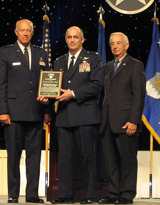 Col. Carlisle A. Lincoln,  commander of the Alaska Air National Guard's 176th Operations Group, accepts the Air Force Association's 2010 Outstanding Air National Guard Unit of the Year award Sept. 13, 2010 in Washington D.C. Michael M. Dunn (right), the Air Force Association president, and Lt. Gen. Harry M. Wyatt III, the Air National Guard director, present the award.