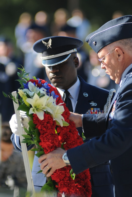 Charlotte, N.C. – Brig. Gen. Iwan Clontz (right) and Chief Master Sgt. Maurice Williams of move a wreath into position during the memorial service honoring North Carolina Air National Guardsmen deceased within the last year. (NCANG photo by Tech. Sgt. Brian E. Christiansen)