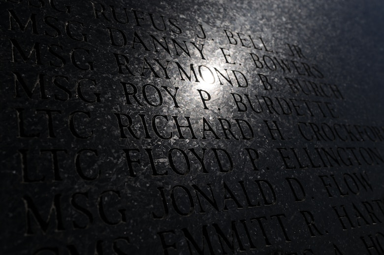 Charlotte, N.C. -- Sunlight is reflected onto names of deceased airmen of the North Carolina Air National Guard during an annual memorial service at the 145th Airlift Wing. (NCANG photo by Tech. Sgt. Brian E. Christiansen)