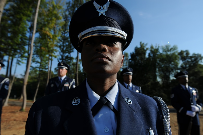 Charlotte, N.C. -- Tech. Sgt. Sheryl Bell of the 145th Airlift Wing honor guard stands at ease during the memorial service honoring North Carolina Air National Guardsmen deceased within the last year. (NCANG photo by Tech. Sgt. Brian E. Christiansen)