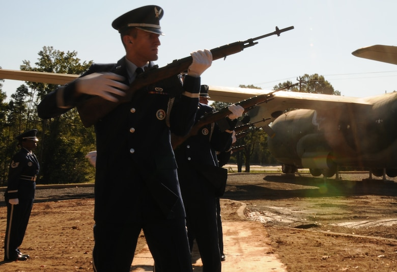 Charlotte, N.C. -- Senior Airman Jonathan Boseman of the 145 Airlift Wing Honor Guard fires his rifle as part of the twenty-one gun salute at the memorial service honoring North Carolin Air National Guardsmen deceased within the last year. (NCANG photo by Tech. Sgt. Rich Kerner)