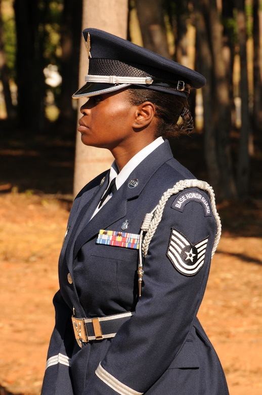 Charlotte, N.C. -- Tech. Sgt. Sheryl Bell of the 145th Airlift Wing Honor Guard reflects upon the memorial service honoring North Carolina Air National Guardsmen deceased in the last year. (NCANG photo by Tech. Sgt. Rich Kerner)