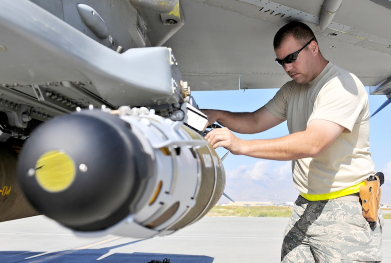 Tech Sgt. Darrin Sather performs a supervisory post load on a guided bomb unit-54 loaded on an F-16 Fighting Falcon Sept. 30, 2010, at Bagram Airfield, Afghanistan. The GBU-54 is the Air Force's newest 500-pound precision weapon, equipped with a special targeting system that uses a combination of Global Position System and laser guidance to accurately engage and destroy moving targets. Sergeant Sather is a weapons expeditor assigned to the 455th Expeditionary Aircraft Maintenance Squadron. (U.S. Air Force photo/Staff Sgt. Christopher Boitz)