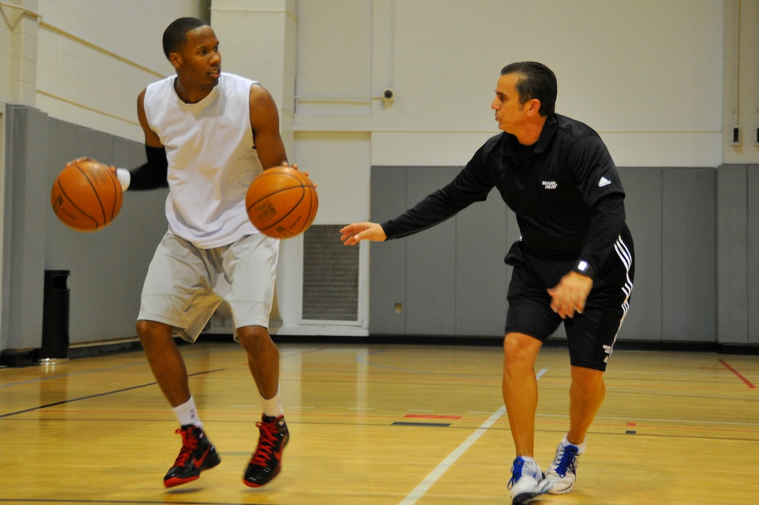 Octavio DeLagrana, Miami HEAT player development coach, watches U.S. Air Force Capt. Antoine Hood, 919th Special Operations Wing, work on his dribbling technique during a workout session at Hurlburt Field, Fla., Sept. 29, 2010. Captain Hood had a college basketball career at the Air Force Academy from 2002-2006.  (DoD photo by U.S. Air Force Senior Airman Sheila deVera/RELEASED)