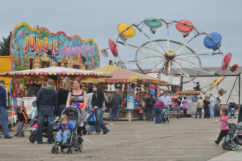 ROYAL AIR FORCE LAKENHEATH, England – Parents and children enjoy the carnival rides at the Holiday Bazaar on Oct. 2. Approximately 1,000 people came to shop the wares of more than 100 vendors from the local community. (U.S. Air Force photo/Senior Airman David Dobrydney)