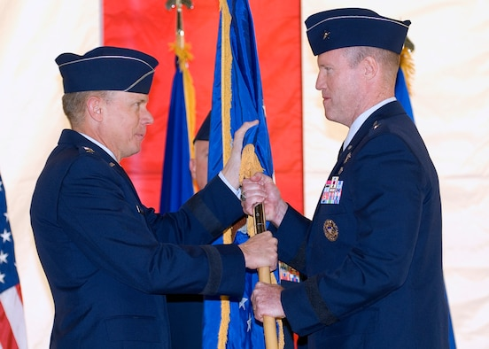 General Donald J. Hoffman, commander of Air Force Materiel Command, hands the Air Force Flight Test Center flag to Brig. Gen. Robert C. Nolan II, signifying the transfer of command Oct. 5.  (Air Force photo by Rob Densmore)