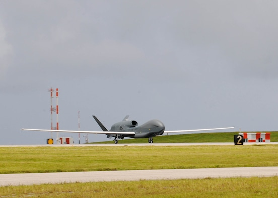 The RQ-4 Global Hawk Andersen Air Force Base, Guam, Oct. 7. This is its first take-off since its arrival ceremony and it's the only permanentlystationed aircraft on Andersen. The Global Hawk's mission is to provide a broad spectrum of intelligence, surveillance and reconnaissance collection capability to support joint combatant forces in worldwide peacetime, contingency and wartime operations. (U.S. Air Force photo/ Senior Airman Nichelle Anderson/released)