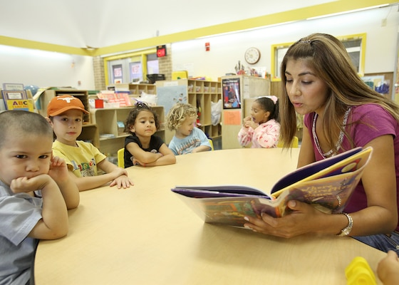 Ana Maria Hunter reads to children at the Lackland Child Development Center Sept. 29 in celebration of Hispanic Heritage Month. The reading is part of a month-long celebration in honor of Hispanic heritage and culture. The month concludes Oct. 14 with an interfaith service at Freedom Chapel. (U.S. Air Force photo/Robbin Cresswell)