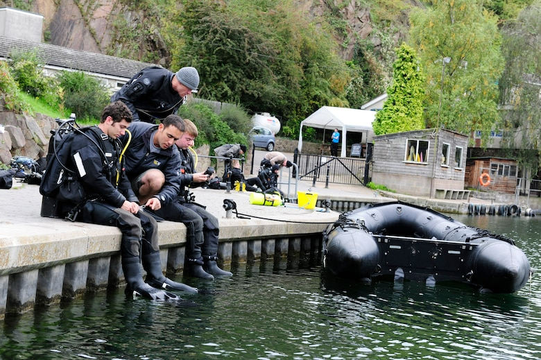 STONEY COVE, England – Pararescuemen from the 56th Rescue Squadron perform equipment checks before entering the water for subsurface search, rescue and recovery training Oct. 5. Pararescumen wear dry suits when training for real-world missions. Dry suits allow protection from exposure to contaminants while in the water.  (U.S. Air Force photo/Airman 1st Class Lausanne Morgan)