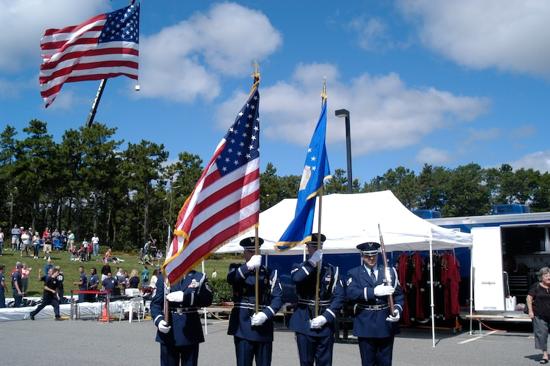 The 102nd Intelligence Wing Honor Guard presents the colors at the 10th annual Seaside LeMans go-kart race, Sept. 11, at Mashpee Commons, Mass.  Seaside LeMans is known as 'The race for the Cape Cod community' and has raised more than $2.8 million since it began in 2001.  All proceeds of the event are donated to The Cape Cod Foundation, which distributes 100 percent of each year's funds to the designated beneficiaries for that year.  (U.S. Air Force photo by Maj. Nicole Ivers)