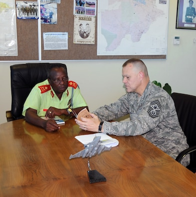 Chief Master Sgt. of the Air Force James A. Roy discusses the enlisted force structure with Botswana Defense Force Air Arm Command Maj. Gen. T.M. Paledi Oct. 11, 2010, during a visit to Thebaphatshwa Air Base, Botswana. Chief Roy and a team from 17th Air Force spent the day discussing enlisted force development members of with the BDF. (U.S. Air Force photo/Master Sgt. Jim Fisher)