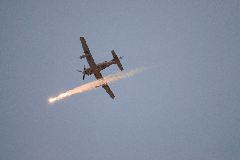 A Hawker Beechcraft AT-6C, modified for various light attack missions, releases flares during an operational test over the Southern Arizona desert Oct. 5. It was the first time flare buckets, or aircraft survivability equipment, were mounted onto the airplane and fully integrated with the control system on board. A team of pilots and engineers certified that the airplane could separate the flares correctly while learning if the modification would have adverse effects on the airplane's handling. The Air National Guard, Air Force Reserve Command Test Center based in Tucson, Ariz., is working with various defense contractors and pilots from across the Air Force this month to evaluate the aircraft's suitability for an array of missions. (Air Force photo by Master Sgt. Dave Neve)