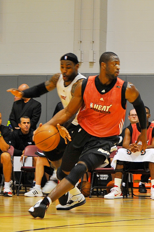 LeBron James, Miami HEAT forward, attempts to steal the ball away from Dwyane Wade, a HEAT guard, during the 2010 Training Camp scrimmage at the Aderholt Fitness Center at Hurlburt Field, Fla., Oct. 1, 2010. (DoD photo by U.S. Air Force Senior Airman Sheila deVera/RELEASED)